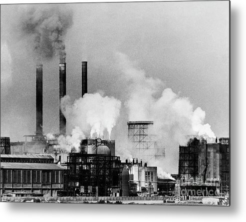 Air Pollution Metal Print featuring the photograph Smoke Rising From Factory Smokestacks by Bettmann