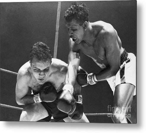 Conspiracy Metal Print featuring the photograph Sugar Ray Robinson Fighting Jake by Bettmann