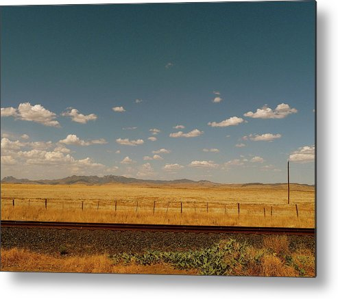 Tranquility Metal Print featuring the photograph Texan Desert Landscape And Rail Tracks by Papilio