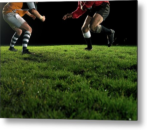 Grass Metal Print featuring the photograph Two Opposing Rugby Players, One Holding by Thomas Barwick