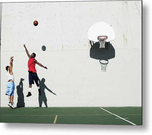 Young Men Metal Print featuring the photograph Two Young Men Playing Basketball by Thomas Barwick