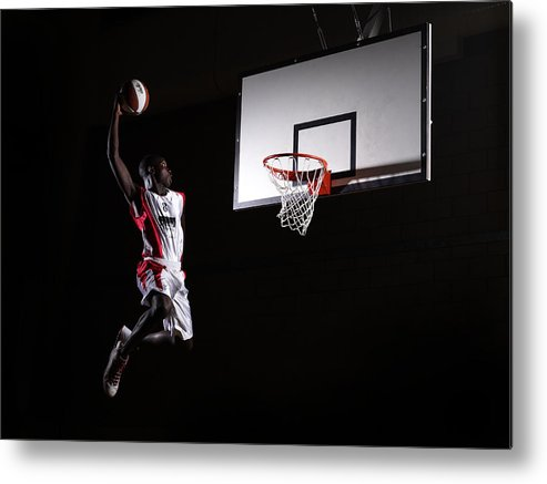 Human Arm Metal Print featuring the photograph Young Man In The Air About To Dunk The by Compassionate Eye Foundation/steve Coleman/ojo Images Ltd