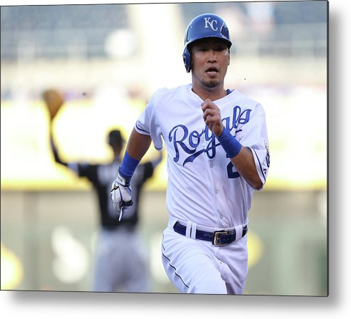 American League Baseball Metal Print featuring the photograph Alcides Escobar by Ed Zurga