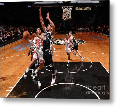 Nba Pro Basketball Metal Print featuring the photograph Cameron Payne and Drazen Petrovic by Jesse D. Garrabrant