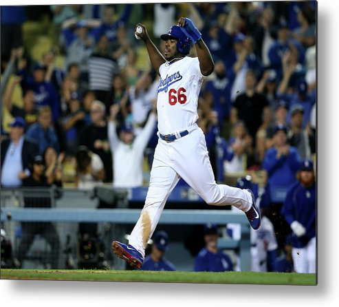 Ninth Inning Metal Print featuring the photograph Yasiel Puig and Howie Kendrick by Stephen Dunn
