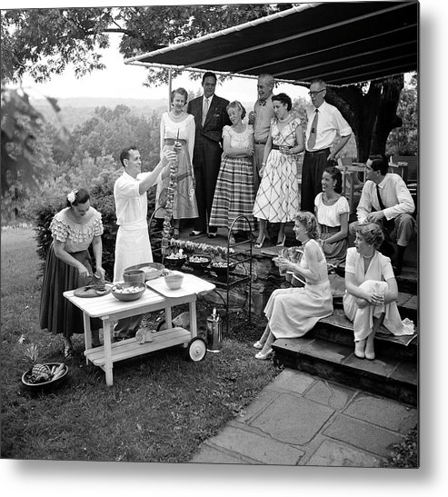 Usa Metal Print featuring the photograph A Gathering Of Well Dressed Guests At A by Nina Leen