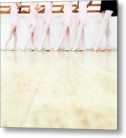 Ballet Dancer Metal Print featuring the photograph Low Section View Of A Line Of Young by Digital Vision.