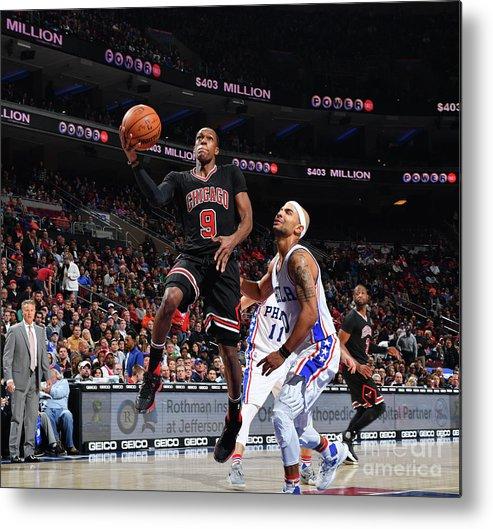 Nba Pro Basketball Metal Print featuring the photograph Rajon Rondo by Jesse D. Garrabrant