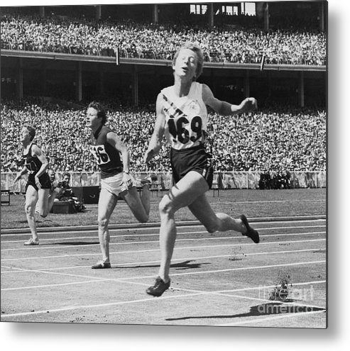 The Olympic Games Metal Print featuring the photograph Hurdlers Racing To Finish Line by Bettmann
