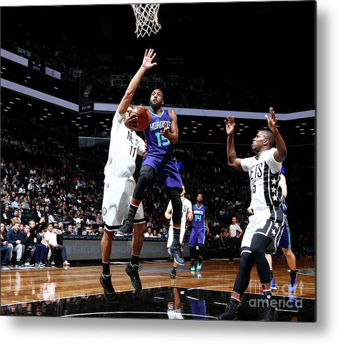Kemba Walker Metal Print featuring the photograph Kemba Walker by Nathaniel S. Butler