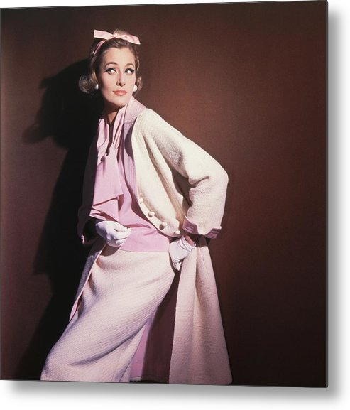 Studio Shot Metal Print featuring the photograph Model Wearing White Coat Over Pink Blouse by Horst P. Horst