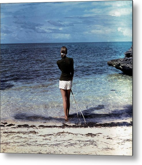 Fashion Metal Print featuring the photograph A Woman On A Beach by Serge Balkin