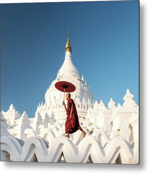 Pagoda Metal Print featuring the photograph Buddhist Monk Walking Across Arches Of by Martin Puddy