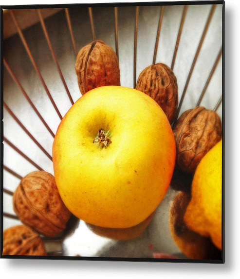 Apple Metal Print featuring the photograph Food still life - yellow apple and brown walnuts - beautiful warm colors by Matthias Hauser