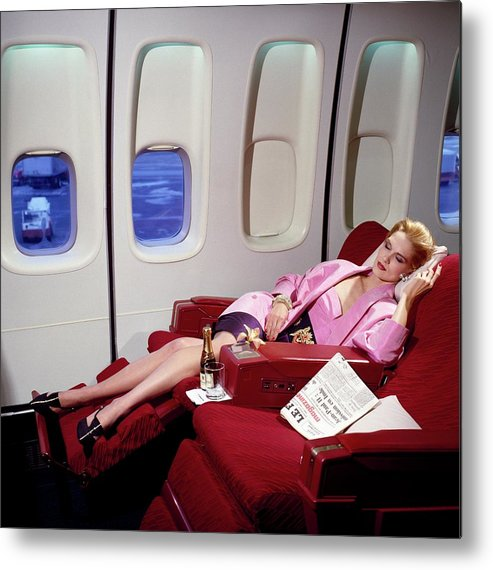 Indoors Metal Print featuring the photograph Model Wearing Pink Jacket On Airplane by Horst P. Horst