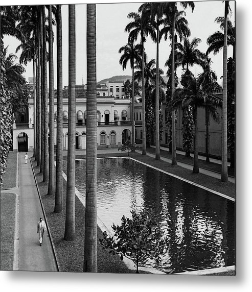 Exterior Metal Print featuring the photograph Palm Trees Bordering A Pool by Luis Lemus