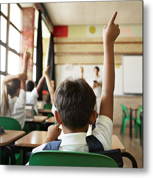 Expertise Metal Print featuring the photograph Rear view of boy with raised hand in class by Klaus Vedfelt