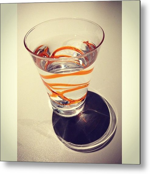 Metal Print featuring the photograph Glass Of Water On Table by Juan Silva