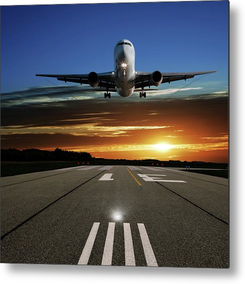 Orange Color Metal Print featuring the photograph Xl Jet Airplane Landing At Sunset by Sharply done