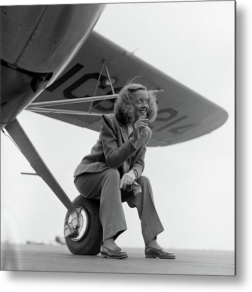 Timeincown Metal Print featuring the photograph Bette Davis With Airplane, 1947 by Loomis Dean