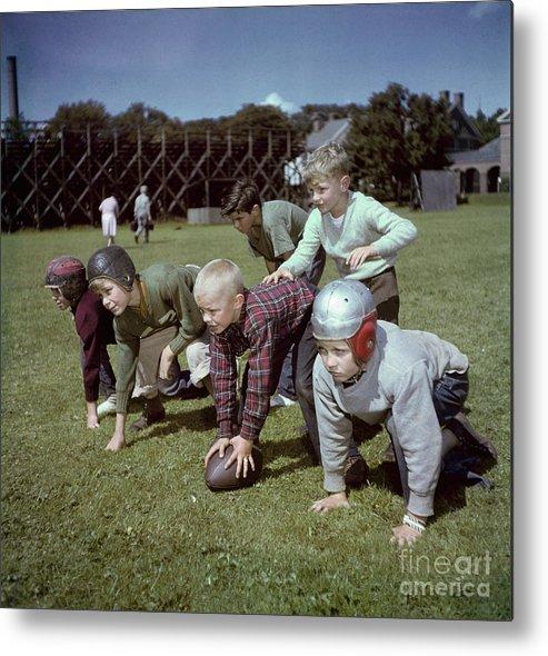 Headwear Metal Print featuring the photograph Boys Playing Football by Bettmann