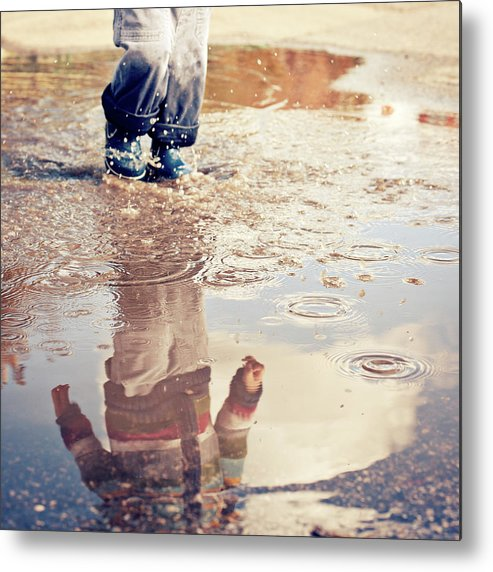 Toddler Metal Print featuring the photograph Child In A Puddle by Vpopovic