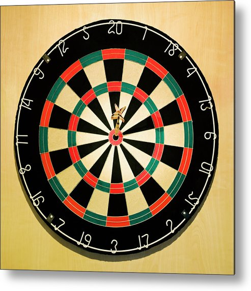 Expertise Metal Print featuring the photograph Dart In Bulls Eye On Dart Board by Fuse