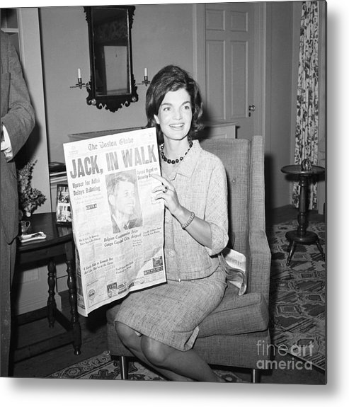 Democracy Metal Print featuring the photograph Jacqueline Kennedy Holding Newspaper by Bettmann