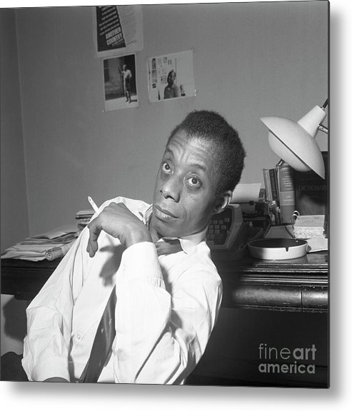 Smoking Metal Print featuring the photograph James Baldwin Sitting Smoking by Bettmann