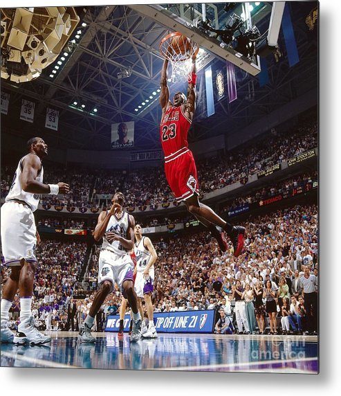 Chicago Bulls Metal Print featuring the photograph Michael Jordan Attempts A Dunk by Nathaniel S. Butler