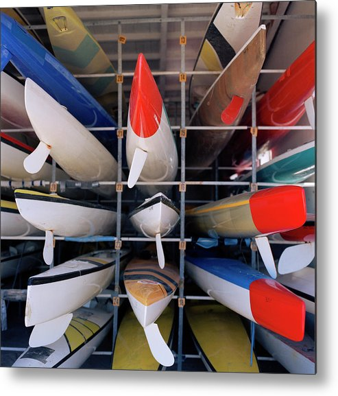 Sport Rowing Metal Print featuring the photograph Rows Of Canoes In Boat House, Close-up by Shoula