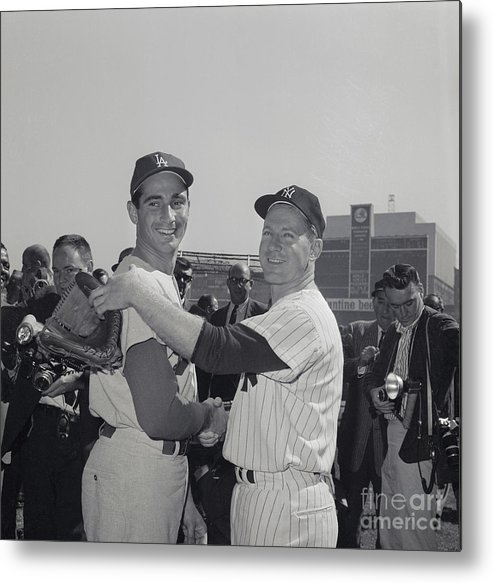 Sandy Koufax Metal Print featuring the photograph Sandy Koufax And Whitey Ford Shaking by Bettmann