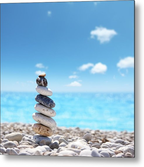Water's Edge Metal Print featuring the photograph Stone Balance On Beach by Imagedepotpro