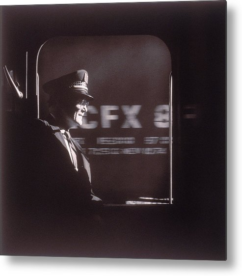 Working Metal Print featuring the photograph Train Conductor Looking Out Of Window by John Coletti