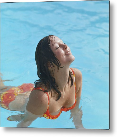 1973 Metal Print featuring the photograph Young Woman In Bikini At Swimming Pool by Tom Kelley Archive
