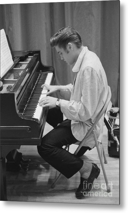 Elvis Presley Metal Print featuring the photograph Elvis Presley On Piano While Waiting For A Show To Start 1956 by The Harrington Collection