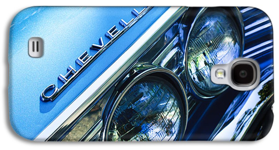 1967 Chevrolet Chevelle Malibu Head Light Emblem Galaxy S4 Case featuring the photograph 1967 Chevrolet Chevelle Malibu Head Light Emblem by Jill Reger