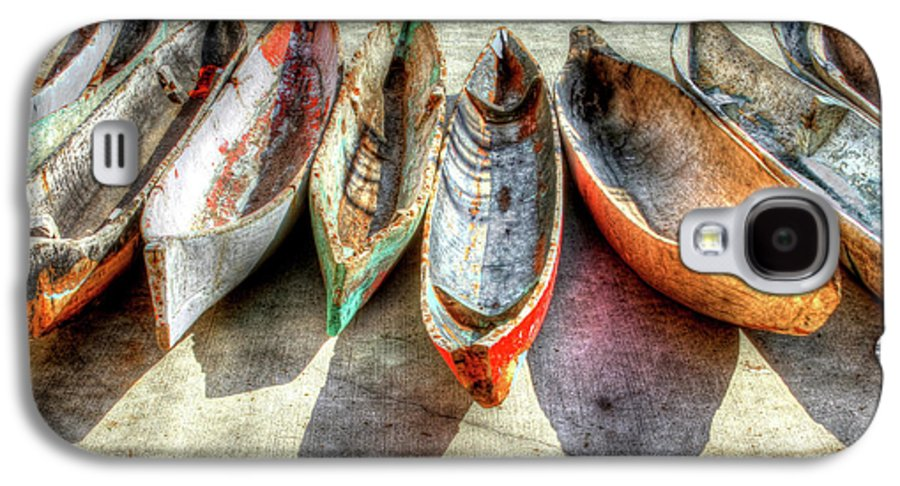 The Galaxy S4 Case featuring the photograph Canoes by Debra and Dave Vanderlaan