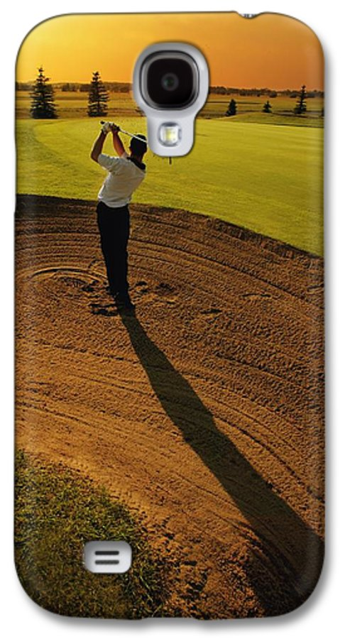 Twilight Galaxy S4 Case featuring the photograph Golfer Taking A Swing From A Golf Bunker by Darren Greenwood