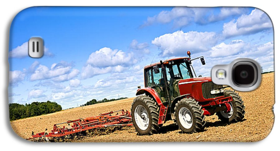 Tractor Galaxy S4 Case featuring the photograph Tractor In Plowed Farm Field by Elena Elisseeva
