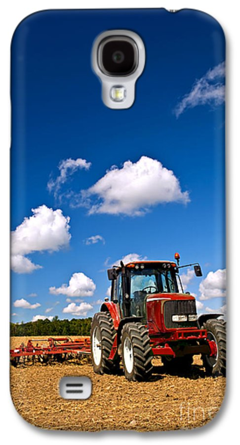Tractor Galaxy S4 Case featuring the photograph Tractor In Plowed Field by Elena Elisseeva