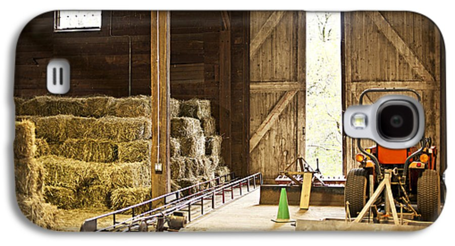 Barn Galaxy S4 Case featuring the photograph Barn With Hay Bales And Farm Equipment by Elena Elisseeva