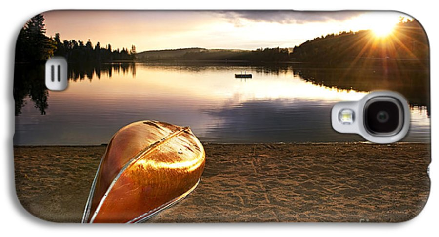 Canoe Galaxy S4 Case featuring the photograph Lake Sunset With Canoe On Beach by Elena Elisseeva