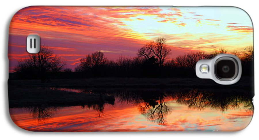 Clouds Galaxy S4 Case featuring the photograph Calming Sunset by Larry Keahey