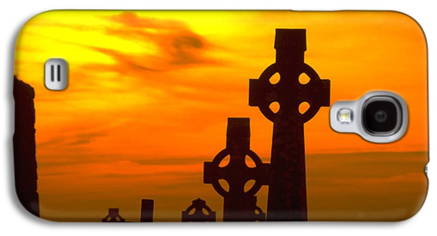 Christian Galaxy S4 Case featuring the photograph Celtic Crosses In Graveyard by Carl Purcell
