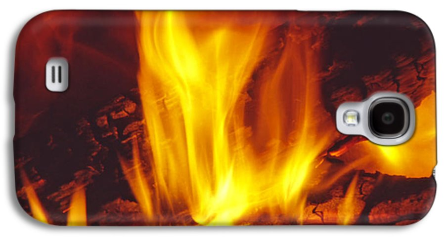Fire Galaxy S4 Case featuring the photograph Wood Stove - Blazing Log Fire by Steve Ohlsen