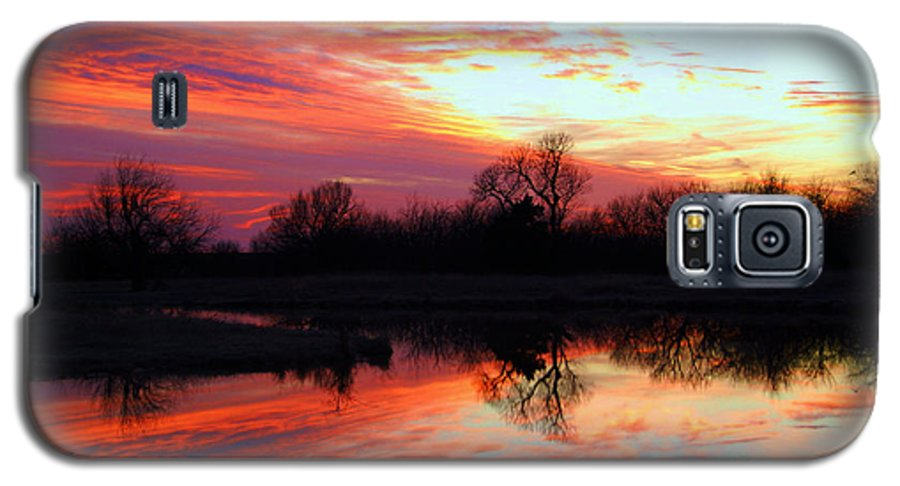 Clouds Galaxy S5 Case featuring the photograph Calming Sunset by Larry Keahey