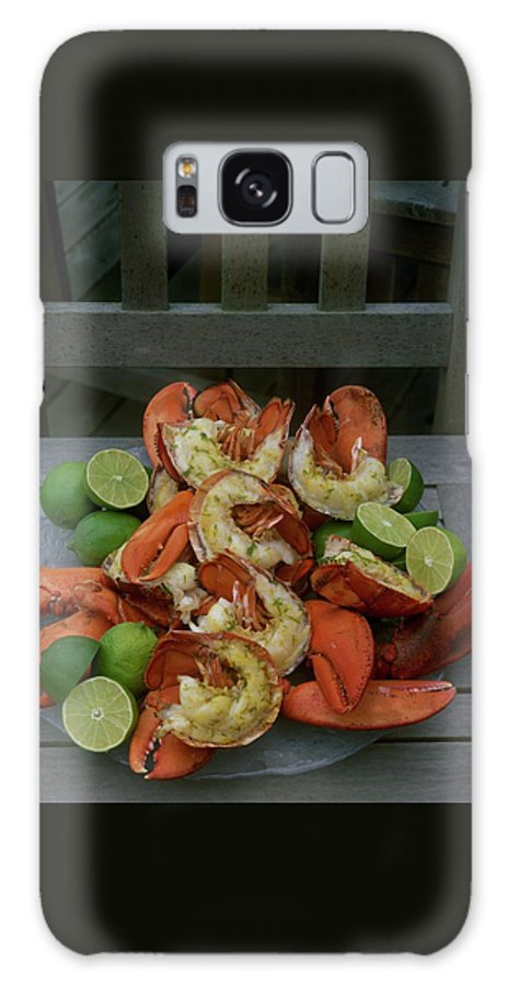 Cooking Galaxy S8 Case featuring the photograph A Meal With Lobster And Limes by Romulo Yanes