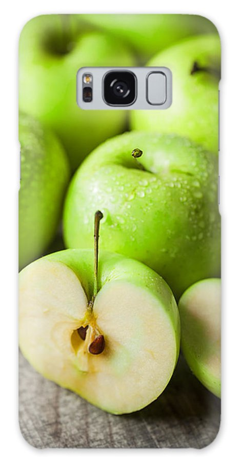 Apple Galaxy S8 Case featuring the photograph Fresh Healthy Green Apples On Wooden Background by Daniel Barbalata