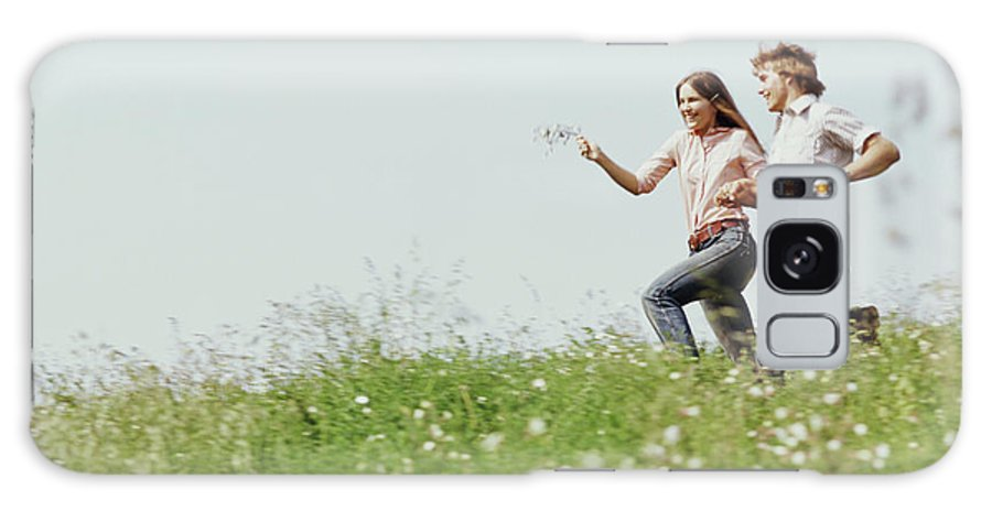 Photography Galaxy S8 Case featuring the photograph 1970s Boy Girl Running Field by Vintage Images